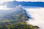 stock photo of bromo  - Village and Cliff at Bromo Volcano in Tengger Semeru national park Java Indonesia - JPG