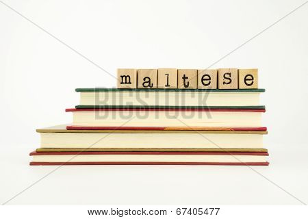 Maltese Language Word On Wood Stamps And Books
