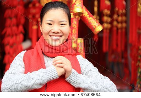 young asian woman wishing you a happy chinese new yea
