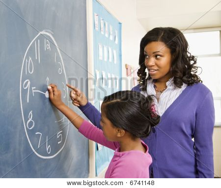 Teacher And Student At Blackboard