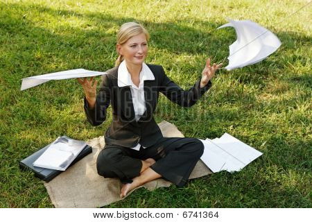 woman in a park engaged in paper cases