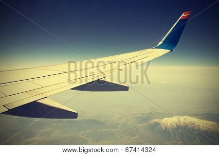 Wing Of The Plane On Blue Sky, Vintage Retro Style.
