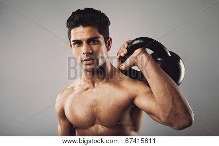 Hispanic Fitness Male Model Holding Kettle Bell