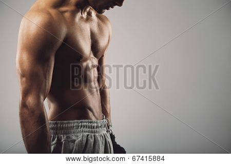 Masculine Young Guy On Grey Background