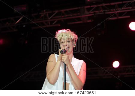 Betty Who singing on stage