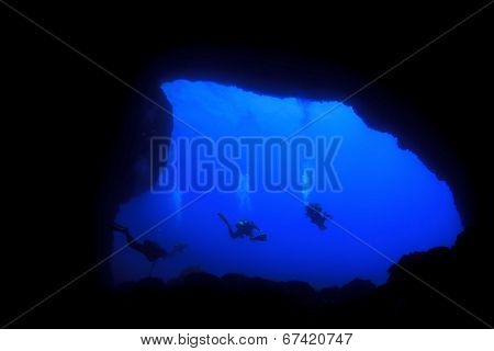 Into Darkness: Underwater cave scuba diving silhouettes