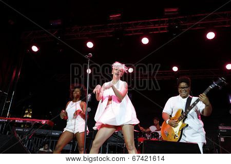 Betty Who with band