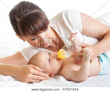 Young Mother Feeding Her Baby From Bottle