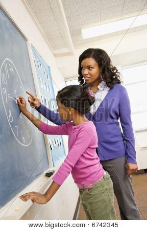 Teacher And Student At Blackboard