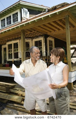 Couple Holding Building Plans