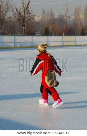 Cute Little Girl On Ice Skates