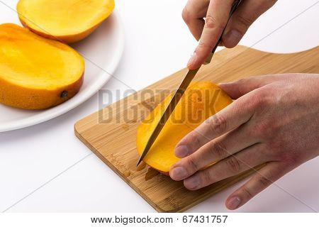 Subdivide the three mango slices
