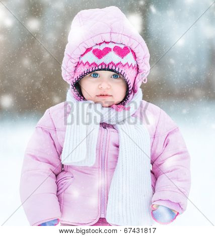first snow. little girl enjoys the arrival of winter