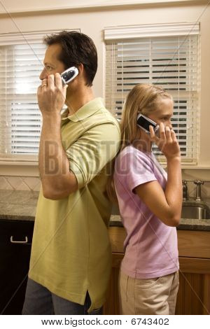 Man And Young Girl On Phones
