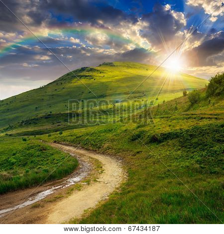 Mountain Path Uphill To The Sky At Sunset With Rainbow