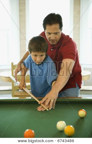 Father And Son Playing Pool
