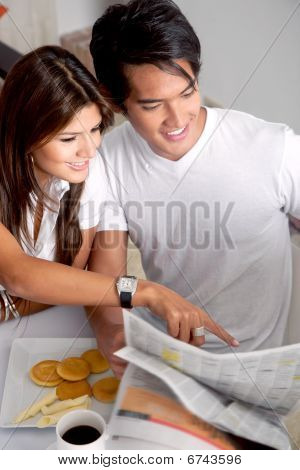Couple Reading The Newspaper