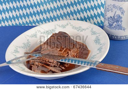 Slicing Sauerbraten (roast Beef)