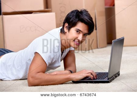 Man Using A Computer While Moving