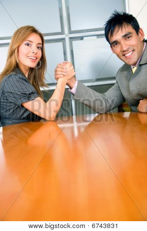 Business Couple Arm-wrestling