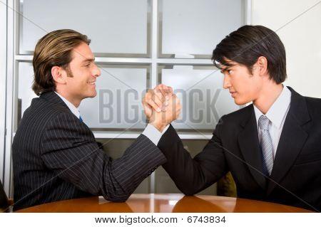 Business Men Arm-wrestling