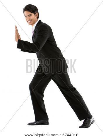 Business Man Pushing A Wall
