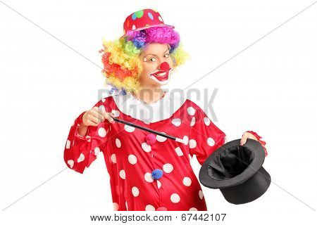 Female clown holding a magician hat isolated on white background