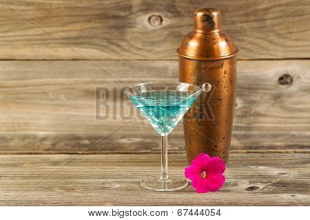 Mixed Drink And Single Flower On Weathered Wood