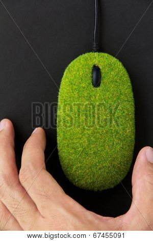 hand with eco computer mouse