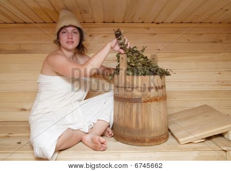 Young Brunette Woman Sitting In Sauna
