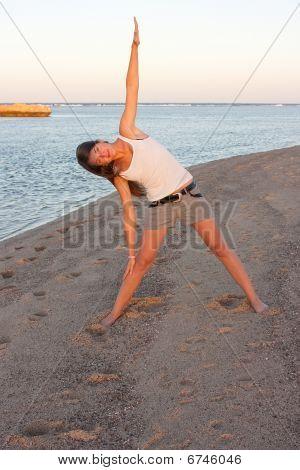 Beautiful Girl Doing Yoga Near Sea