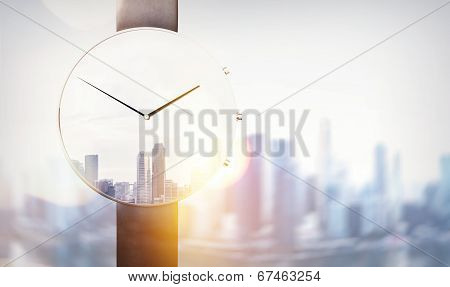 Double exposure of watch and megalopolis
