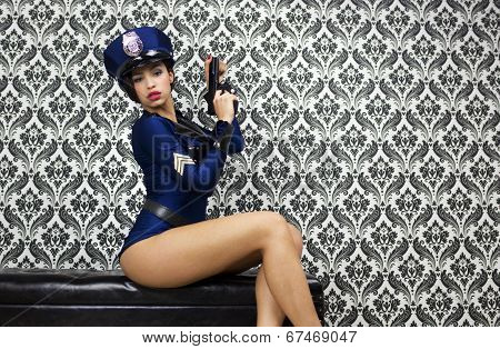 Sexy Police Woman Poses Against Vintage Wallpaper