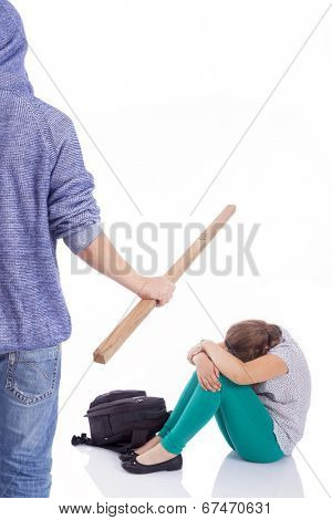 Boy beaten with wooden stick on a little girl, isolated on a white background
