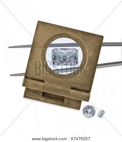 vintage loupe over diamond and tweezers, two diamonds on side