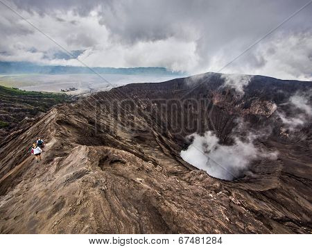 Hikers Walking Around the Rim of Gunung Bromo Volcano, East Java, Indonesia