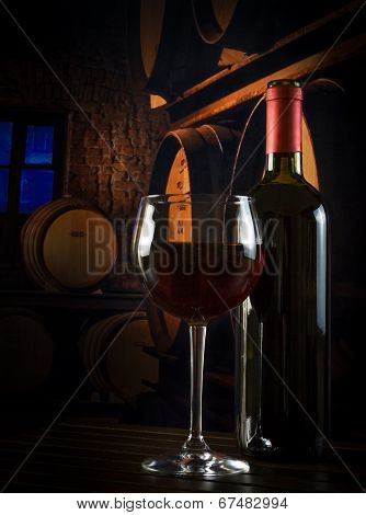 Wine Glass Near Bottle In Old Wine Cellar