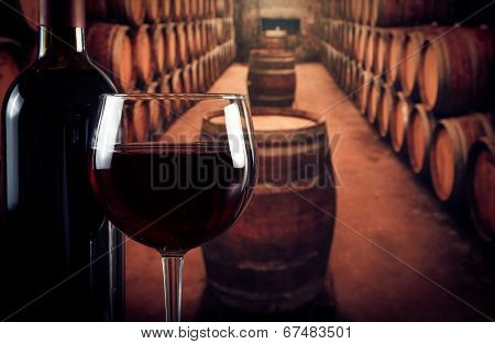 Wine Glass Near Bottle In Old Wine Cellar With Space For Text