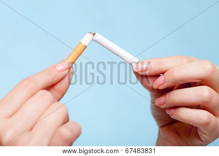 Addiction. Hands Breaking Cigarette. Quit Smoking.