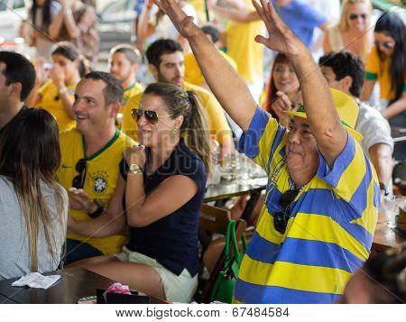 Cheerful Brazil Fans Watching World Cup Football Match at a Bar
