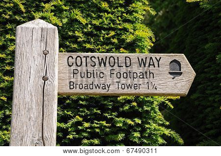 Wooden Cotswold Way sign.