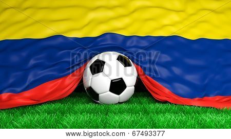Soccer ball with Colombian flag on football field closeup