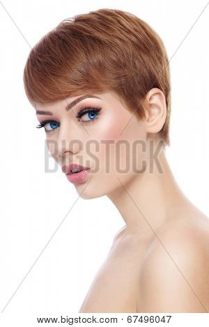 Young beautiful woman with stylish short haircut and fresh make-up over white background