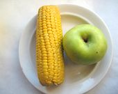 pic of indian apple  - This is cooked corn and green apple on white plate - JPG
