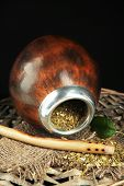 picture of calabash  - Calabash and bombilla with yerba mate isolated on black - JPG