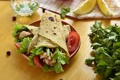 stock photo of pita  - Pita bread stuffed with vegetables and fish - JPG