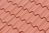 foto of red roof tile  - Tiled red roof for background use - Angled