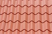 foto of red roof tile  - Tiled red roof - wavy lines for background
