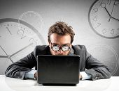 picture of addict  - Internet addiction concept with clock in the glasses - JPG