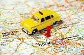pic of koln  - Red push pin pointing at ColnGermany map and a taxi - JPG